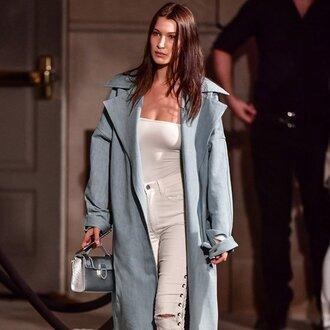 popsugar fashion blogger jeans coat celebrity style celebrity blue coat long coat white top top lace up pants lace up white pants pants bag silver bag bella hadid
