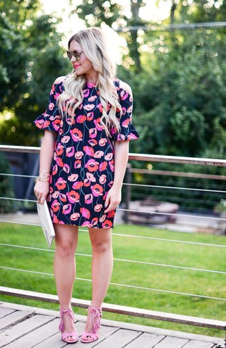 all dolled up blogger jewels sunglasses bag shoes floral dress bell sleeves mini dress pink dress clutch pink heels lace up heels