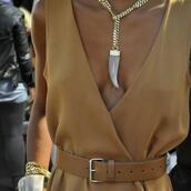 jewels,celebrity,jumpsuit,fang,gold chain,chain,top,necklace,jewelry