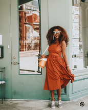 dress,orange dress,sneakers,sunglasses,bag