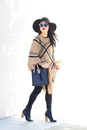 it's not her it's me blogger poncho leather bag felt hat
