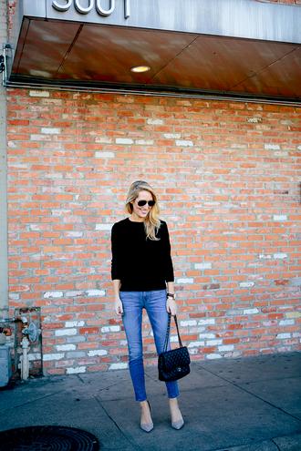 krystal schlegel blogger jeans sunglasses black sweater