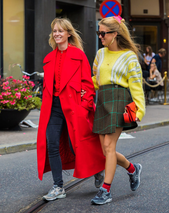 coat skirt stockholm fashion week streetstyle red coat long coat sneakers low top sneakers mini skirt wrap skirt sweater yellow bag denim jeans grey jeans