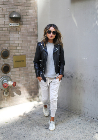 sincerely jules blogger perfecto leather jacket grey sweater white pants white sneakers sunglasses