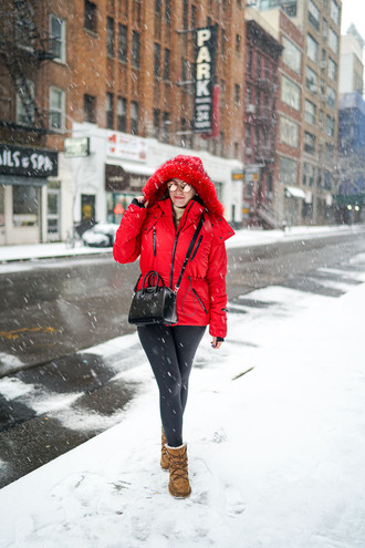covering bases blogger red coat puffer jacket red jacket jacket leggings black leggings bag black bag givenchy givenchy bag crossbody bag sunglasses mirrored sunglasses cold weather outfit hooded jacket