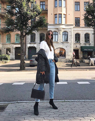 coat down jacket tumblr camouflage shirt white shirt denim jeans blue jeans boots sock boots bag black bag fall outfits