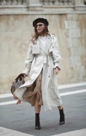 hat,beret,black beret,coat,trench coat,long coat,skirt,midi skirt,boots,black boots,ankle boots,sunglasses,backpack