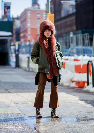 hat brown pants nyfw 2017 fashion week 2017 fashion week streetstyle fur hat jacket army green jacket bomber jacket green bomber jacket khaki bomber jacket pants cropped pants boots printed boots