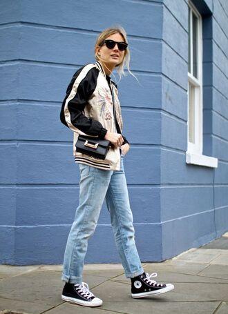 jacket ripped jeans satin bomber converse black converse blue jeans acid wash jeans crossbody bag black crossboody bag bomber jacket saint laurent saint laurent bag black sunglasses embroidered jacket