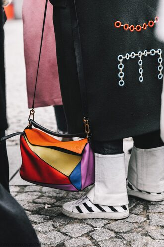 bag tumblr fashion week 2017 streetstyle colorful colorblock multicolor printed bag loewe bag sneakers white sneakers stripes coat black coat black long coat long coat eyelet detail