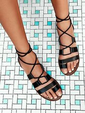 shoes,sandals,leather sandals,black sandals,flat sandals,free people,strappy flats,black low heel sandals