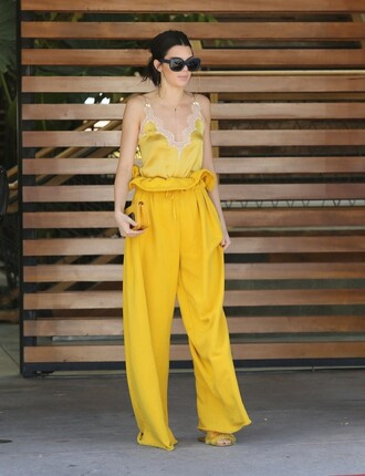 top camisole kendall jenner yellow yellow top wide-leg pants pants kardashians
