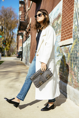 chicityfashion blogger loafers long coat leather pouch grey bag black loafers white coat jeans white long coat white oversized coat