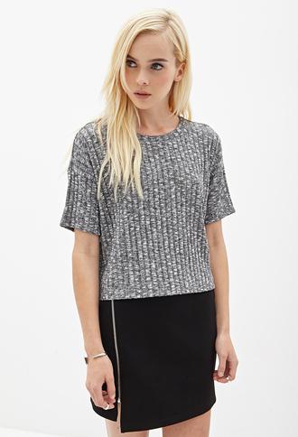 boxy grey grey t-shirt zip black skirt blonde hair