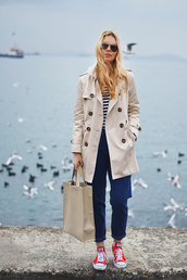 ag on i ya,blogger,jeans,trench coat,striped top,casual,red shoes,tote bag,red converse,top,blue jeans,cuffed jeans,mom jeans,camel,camel coat,nude coat,nude bag,sunglasses,red sneakers,sneakers,low top sneakers,aviator sunglasses,fall outfits