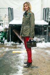 pants,nyfw 2017,fashion week 2017,fashion week,streetstyle,red pants,vinyl,leather pants,bag,boxed bag,louis vuitton,louis vuitton bag,boots,black boots,pointed boots,jacket,army green jacket