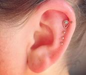 jewels,delicate jewelry,ear,gold,green,stone,teardrop,raindrop,earrings,stud earrings,fine jewelry,cartilage,ear piercings,earings