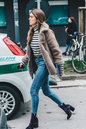 shoes,blue boots,velvet boots,velvet shoes,boots,high heels boots,velvet,denim,jeans,blue jeans,skinny jeans,top,long sleeves,turtleneck,striped top,coat,brown coat,fur coat,winter outfits,streetstyle,velvet ankle boots,camel shearling coat,cold weather outfit,striped turtleneck,striped turtleneck sweater,purple boots,ankle boots,cropped jeans,stripes,jacket,nude jacket,shearling,shearling jacket,brown shearling jacket
