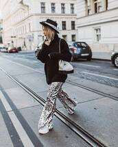 hat,sweater,knitted sweater,black sweater,oversized sweater,pants,wide-leg pants,sequins,sneakers,shoulder bag