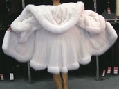 coat,white,fluffy,fuzzy coat,fur coat,draped,poncho,hoodie,silky,winter sweater,pullover,jacket,long fur coat,cape,coat cape,warm,winter coat,cape jacket,fashion,style,white coat,sheer,faux fur,faux fur jacket,white fur,fur