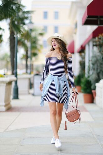 shoes crossbody bag striped dress southern curls and pearls blogger keds white sneakers stripes off the shoulder straw hat denim jacket brown bag mini bag summer dress summer outfits