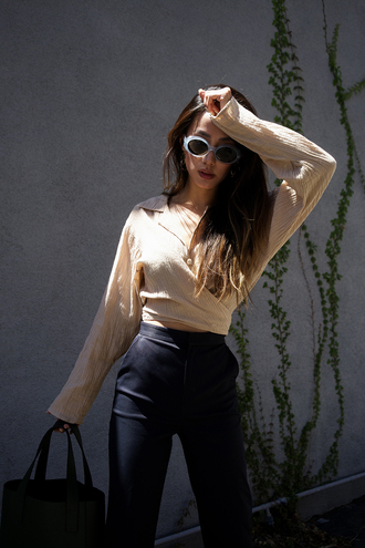neon blush blogger blouse pants sunglasses bag jewels tumblr black pants top nude top wrap top