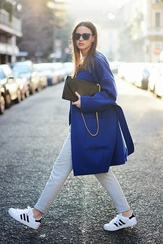 shoes blue coat black purse boyfriend jeans white adidas sneakers blogger sunglasses