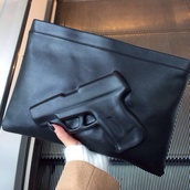 bag,gun,black,gun black clutch,leather,dark,clutch,pistol black,weapon,tumblr,imprint,pistol,pockets,lime,purse,black bag,little,cool,gangsta,style,hand,black clutch,black clutch bag,gun bag