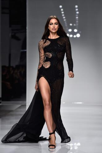 dress gown prom dress asymmetrical dress black dress sandals irina shayk model runway haute couture slit dress long prom dress black fashion week long dress fashion week 2016 versace