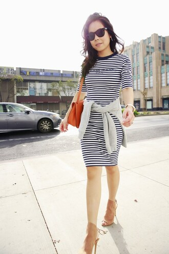 hautepinkpretty blogger dress sweater jewels sunglasses orange bag striped dress booties
