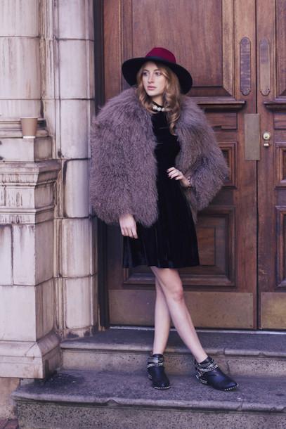 at fashion forte blogger hat fluffy ankle boots winter jacket black dress
