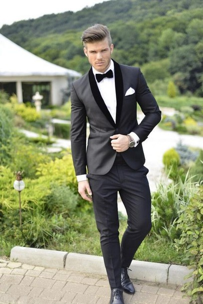 Tuxedos are very closely associated with Black and White. That's because, according to Black Tie standards, typically a tuxedo is just that. Black coat, trousers, bow tie, and waist coverings, with a white shirt underneath to create contrast. Navy/Midnight Tuxedos and Suits are actually more formal than black, and are generally best.