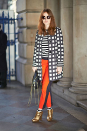 shoes,gold boots,tumblr,ankle boots,high heels boots,pants,orange,coat,checkered,printed coat,top,stripes,striped top,sunglasses,streetstyle,fall outfits,bag,black bag,chain bag
