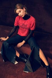 top,pants,model,hailey baldwin,editorial,red top,t-shirt,black pants,slit pants,slit