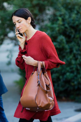 bag fashion week street style fashion week 2016 fashion week paris fashion week 2016 red dress mini dress long sleeves long sleeve dress brown bag streetstyle
