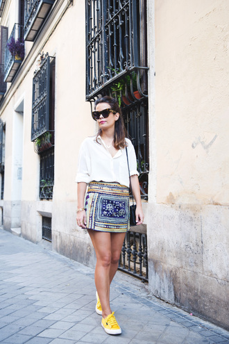 skirt embroidered skirt mini skirt printed skirt shirt white shirt collage vintage blogger sneakers yellow sneakers sunglasses black sunglasses bag black bag shoulder bag streetstyle summer outfits shoes yellow sneaker colorful skirt gold bracelet black purse