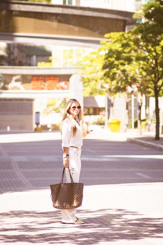 my blonde gal blogger bag blouse jewels sunglasses