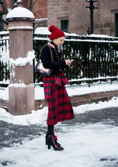 skirt,nyfw 2017,fashion week 2017,fashion week,streetstyle,midi skirt,red skirt,tartan,plaid skirt,tartan skirt,boots,black boots,high heels boots,tights,opaque tights,ankle boots,lace up boots,winter outfits,winter boots,jacket,bomber jacket,baseball jacket,teddy jacket,pom pom beanie,beanie,winter look,bag,black jacket