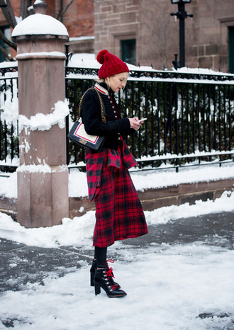 skirt nyfw 2017 fashion week 2017 fashion week streetstyle midi skirt red skirt tartan plaid skirt tartan skirt boots black boots high heels boots tights opaque tights ankle boots lace up boots winter outfits winter boots jacket bomber jacket baseball jacket teddy jacket pom pom beanie beanie winter look bag black jacket