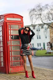 preppy fashionist,blogger,sweater,skirt,tights,bag,shoes,sunglasses,black sweater,mini skirt,leather skirt,shoulder bag,red boots,fishnet tights