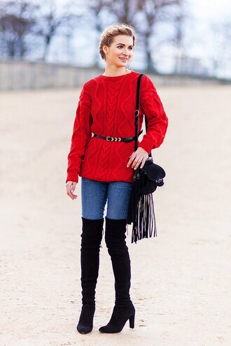 sweater red cable knit sweater red sweater cable knit denim jeans blue jeans belt waist belt boots black boots high heels boots thigh high boots over the knee boots bag fringes fringed bag black bag streetstyle