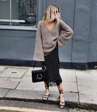 sweater bell sleeve sweater tumblr nude sweater v neck bell sleeves sweater over dress slip dress polka dots lace dress black dress dress sandals flat sandals black sandals bag j w anderson black bag streetstyle