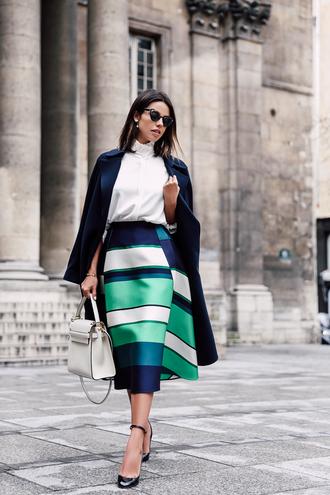viva luxury blogger coat blouse sunglasses jewels white blouse blue coat white bag black heels midi skirt