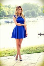 dress,blue,blue dress,gold,necklace,blue heels,blonde hair,sea,grass,pretty,cute,wristband,formal dress,jewelry,mini dress,short dress,prom dress,shoes,heels,style,fashion,cute dress,royal blue dress