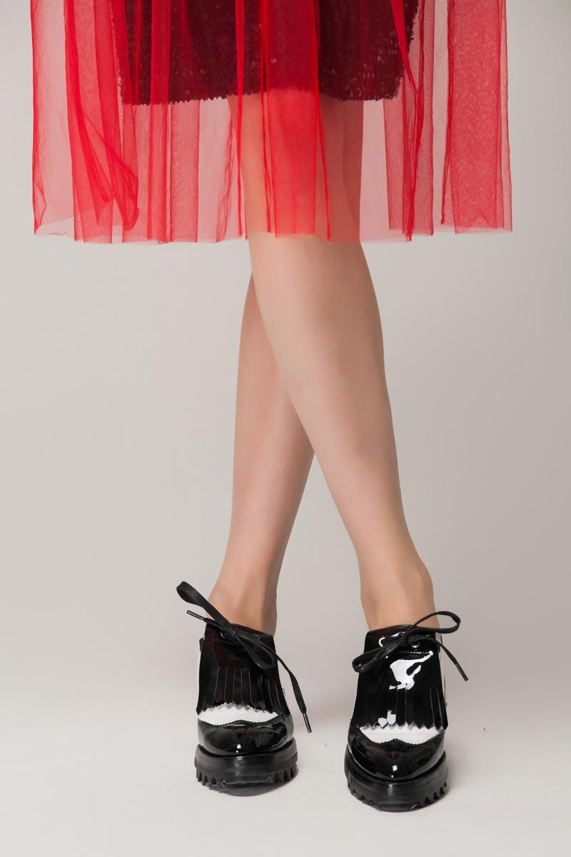 Monochrome brogue flat shoes