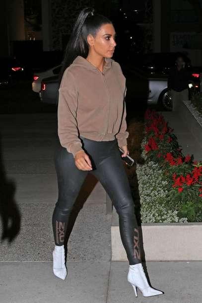sweater kim kardashian kardashians fall outfits hoodie boots leggings
