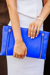bag,clutch,electric blue,electric blue clutch,white,white dress,leather clutch,oversized envelope clutch,watch,ring,pencil dress,jewels,hand chain,gold hand chain,jewelry,gold,hand jewelry,bracelets