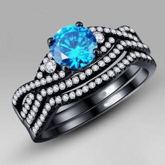 jewels round blue sapphire ring set three pieces ring set four-prong set 1.0 ct round cut blue sapphire three-piece wedding ring set ring set black gold ring set white diamond side stones evolees.com