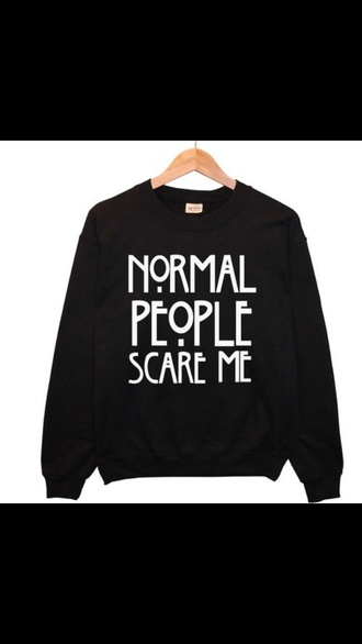 american horror story black sweater white writing