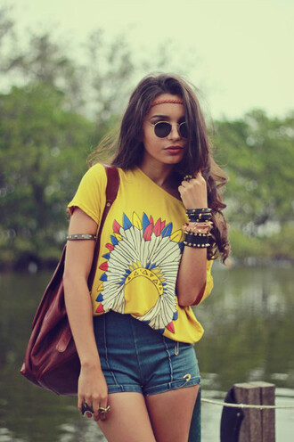 t-shirt yellow indian colorful feathers shorts hippie boho bohemian summer shirt jewels throwback glasses graphic tee top tribal pattern sunglasses yellow top round sunglasses bracelets denim shorts indie vintage gypsy style yellow t-shirt backpack